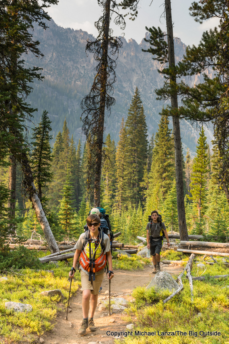 Teenage boys backpacking to the Cramer Lakes, Sawtooth Mountains, Idaho.