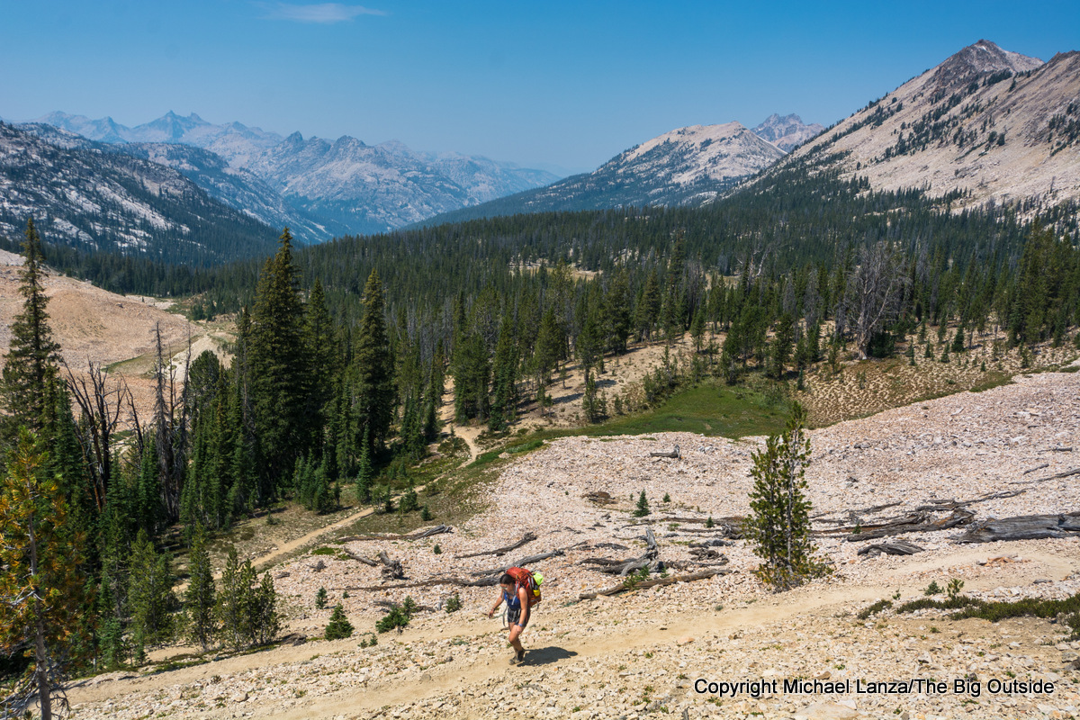 A backpacker on Trail 452 to Sand Mountain Pass, Sawtooth Mountains, Idaho.