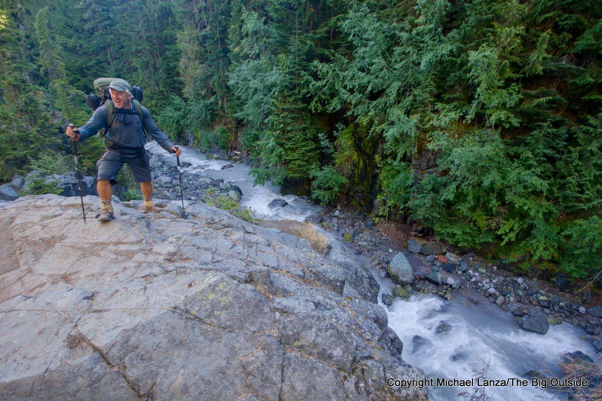 A backpacker above Fryingpan Creek on the Wonderland Trail, Mount Rainier National Park.