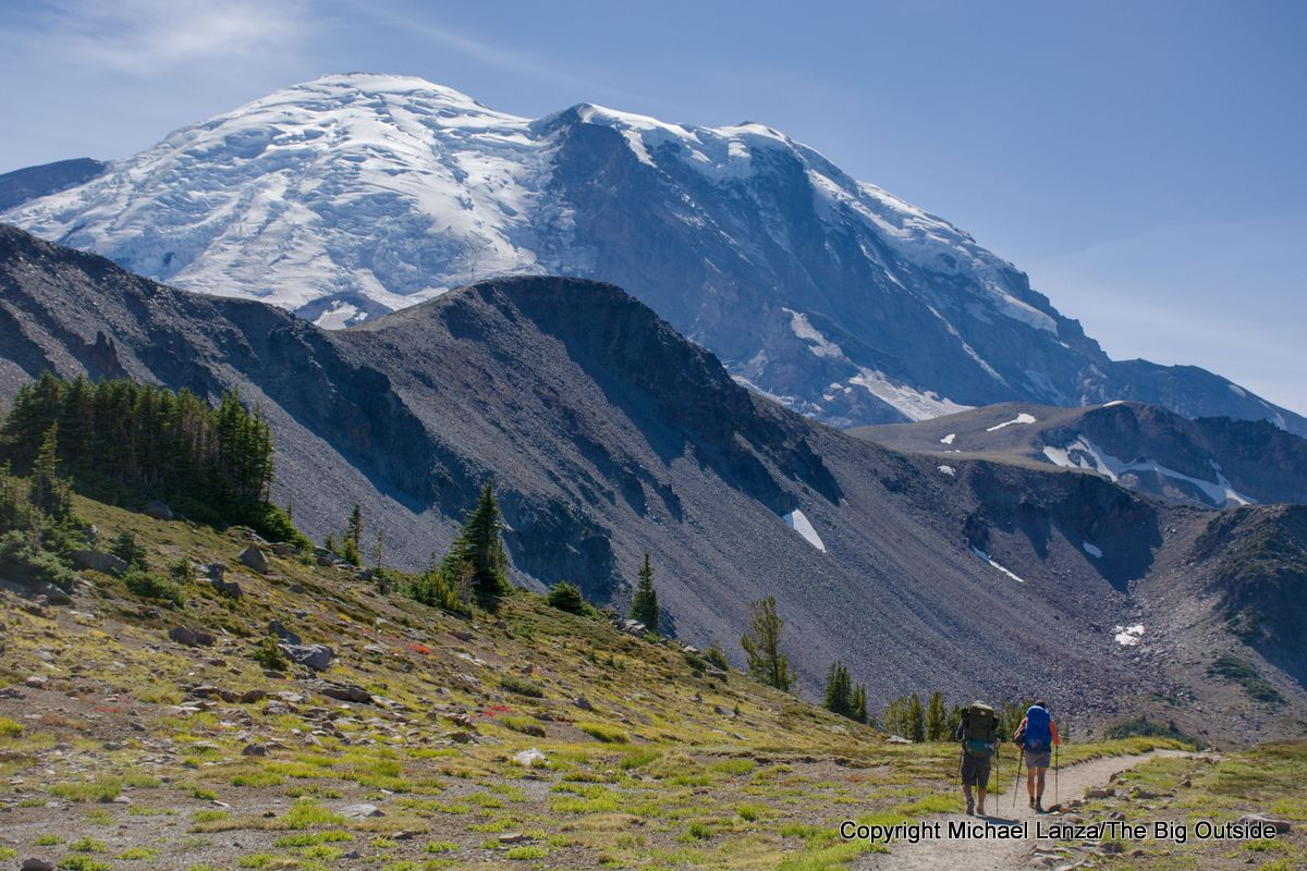 Backpackers on the Wonderland Trail west of Sunrise in Mount Rainier National Park.