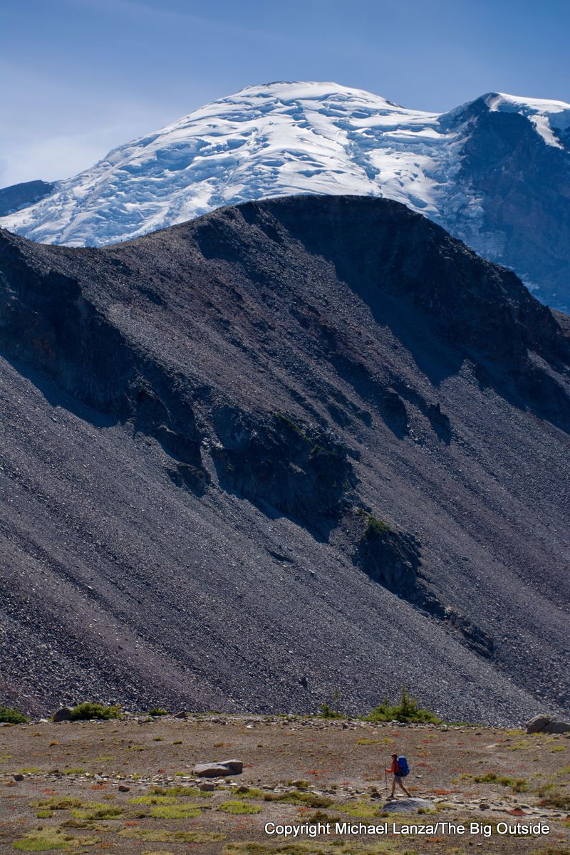 A backpacker west of Sunrise on the Wonderland Trail, Mount Rainier National Park.