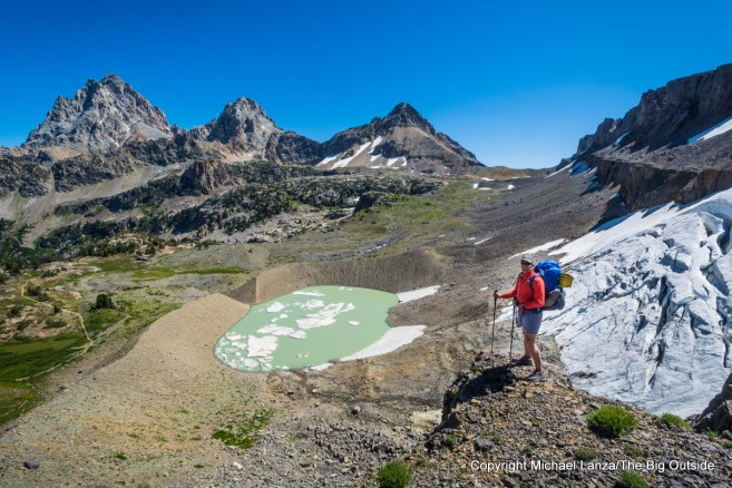 A backpacker above the South Fork Cascade Canyon on the Teton Crest Trail, Grand Teton N.P.
