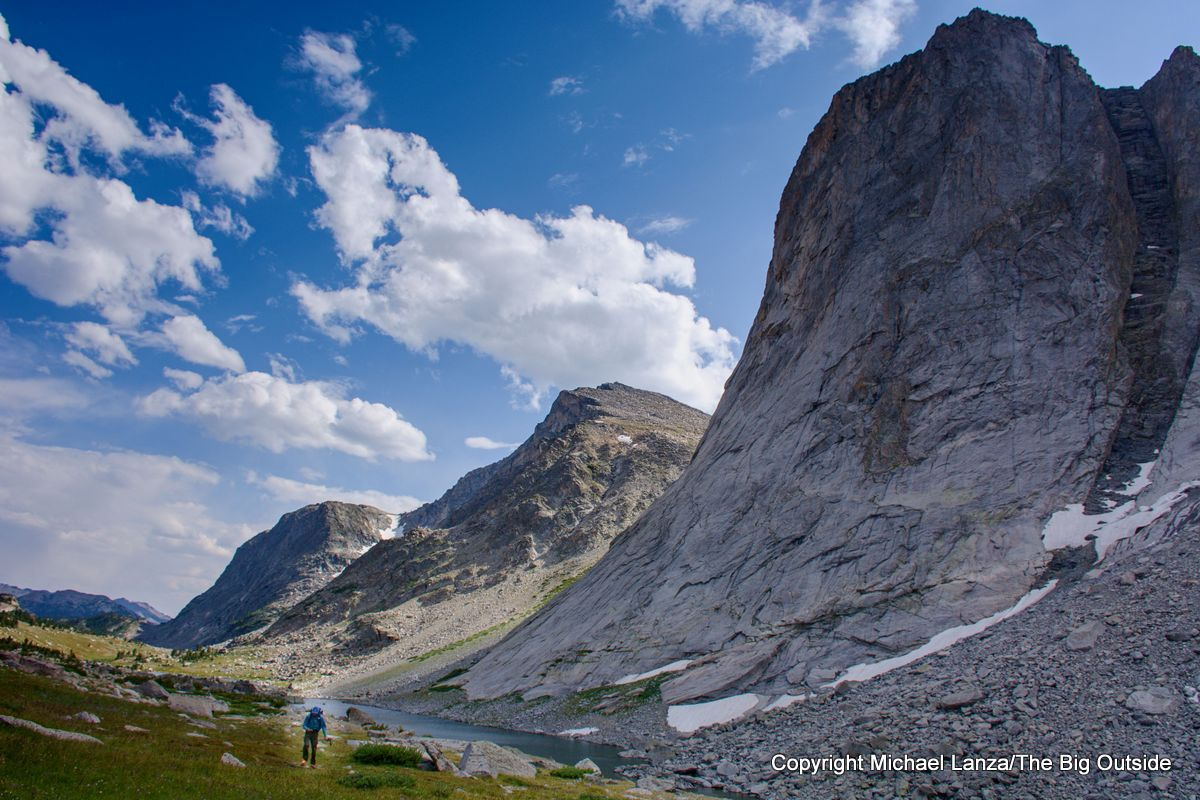 A backpacker in the East Fork River Valley on the Wind River High Route, Wyoming.