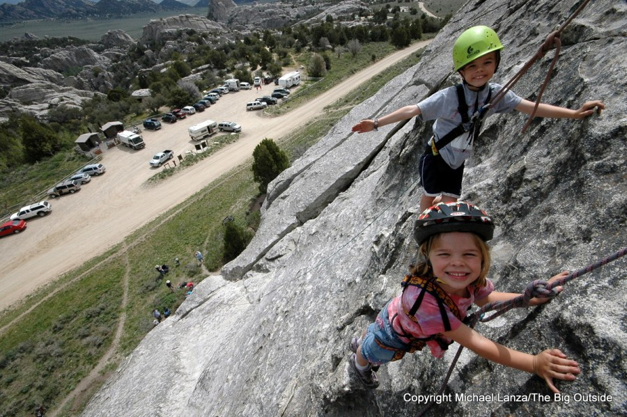 Young children rock climbing at Idaho's City of Rocks National Reserve.