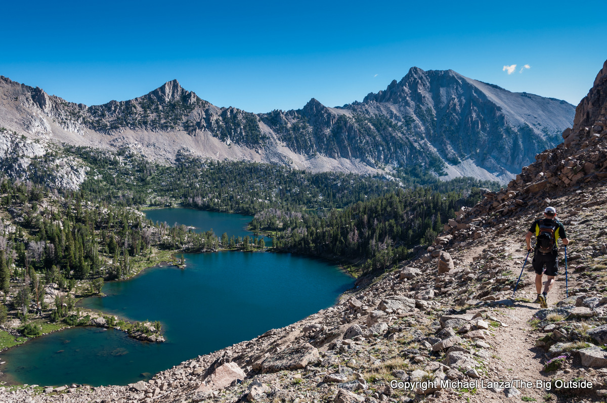 A hiker above Scoop Lake in the Boulder Chain Lakes, White Cloud Mountains, Idaho.