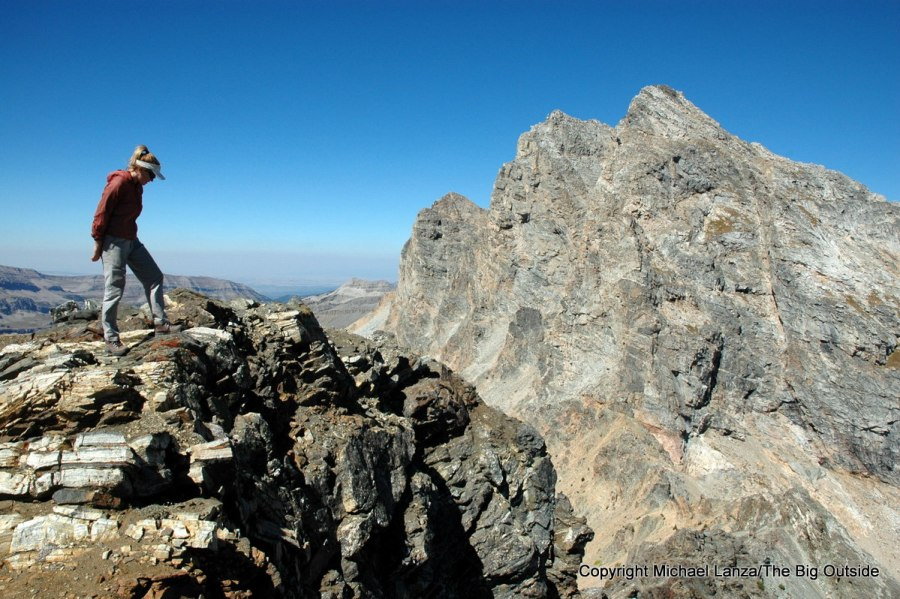 A hiker on the summit of Static Peak in Grand Teton National Park.