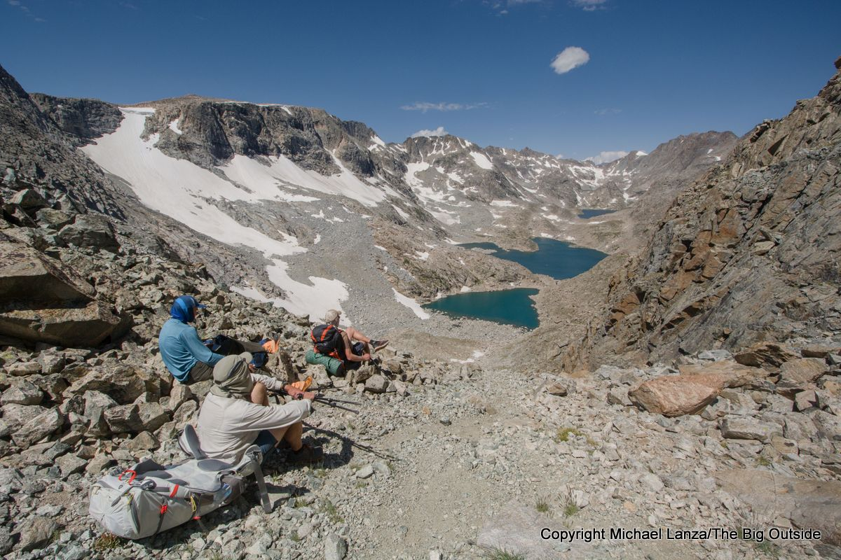 Backpackers at Douglas Peak Pass, overlooking the Alpine Lakes on the Wind River High Route.