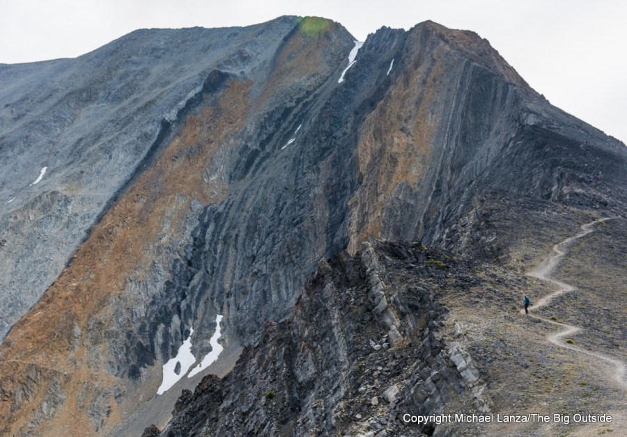 A hiker heading toward Chickenout Ridge on Idaho's 12,662-foot Borah Peak.