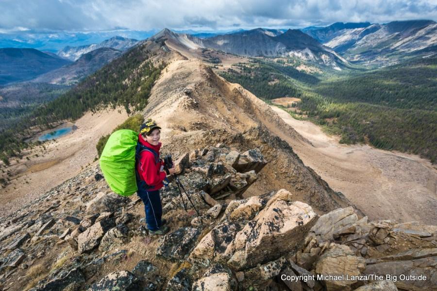 A teenage boy backpacking in Idaho's White Cloud Mountains.