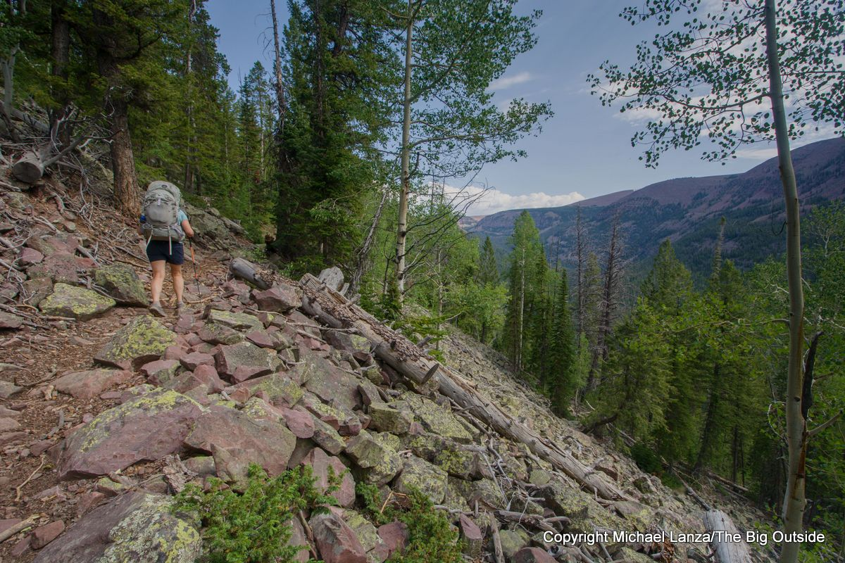 A backpacker on the Chain Lakes Atwood Trail 43, High Uintas Wilderness, Utah.