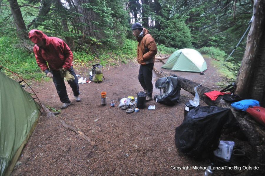 Backpackers at a rainy camp along the High Divide Trail in Olympic National Park.