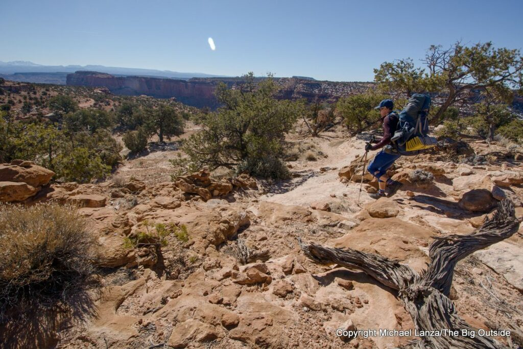 A backpacker on the North Canyon Trail in the Maze District, Canyonlands National Park.