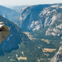 A hiker atop Half Dome, Yosemite National Park.