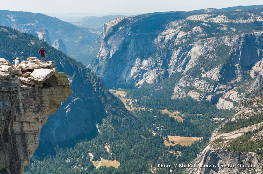 A hiker atop Half Dome, Yosemite National Park.