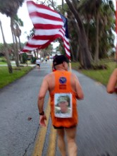 running with a dedication on his back
