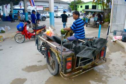 7. guy on motorbike with trailer