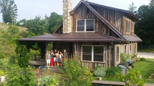 Steven, Beverly and family in front of their lovely wooden house. Mars Hill, NC.