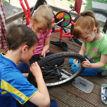 J. teaches his own sister A. how to mend her puncture next day