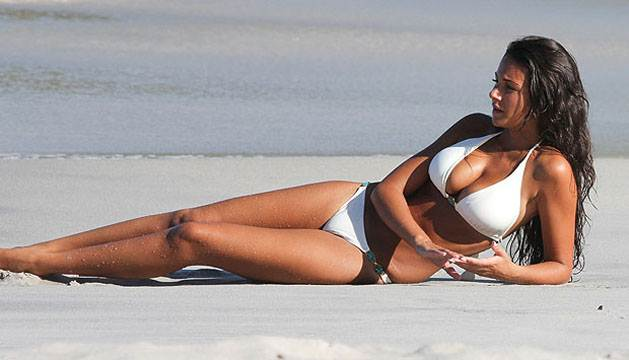 Michelle Keegan on beach in bikini
