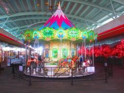 The NO ADULTS carousel at Maya Mall
