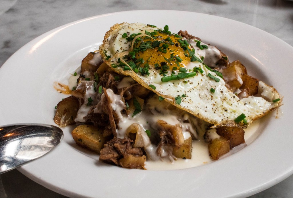 The Short Rib Hash from Wright & Co in Detroit, MI has roasted potatoes, a fried egg, and horseradish sauce. Find the full post at www.thebite2night.com