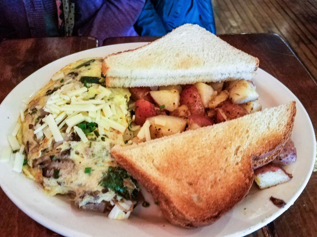 The Omelette Special from Mudgie's Deli in Detroit, MI includes red onion, mushroom, arugula, and a blend of herbed cheeses. It's served with toast and crispy home style potatoes. Find the full post at thebite2night.com