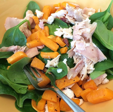 warm chicken and sweet potato over spinach salad