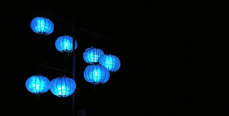 Blue paper lanterns alit in the darkness
