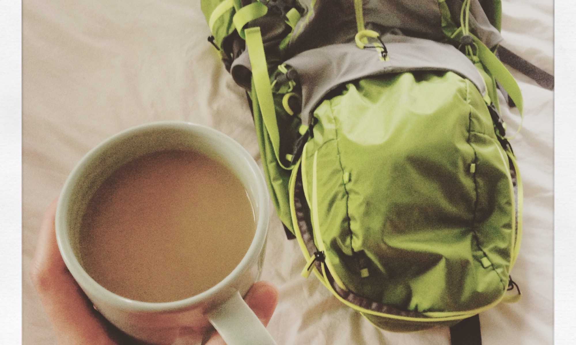 Photo of a cup of tea and a backpack