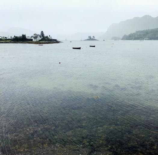 Photo of boats on a loch on a cloudy day