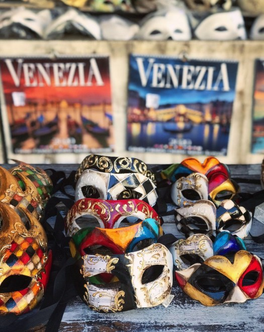 Photo of Venetian masks and calendars for sale at a tourist shop