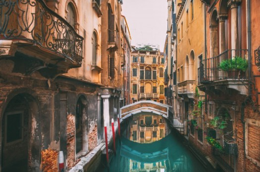 Photo of a bridge over a narrow canal in Venice
