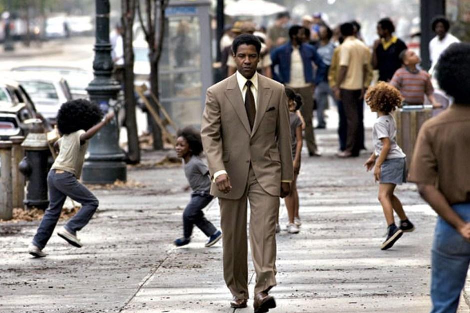 Denzel Washington walks with purpose in American Gangster.