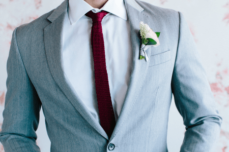 Light grey men's wedding suit.