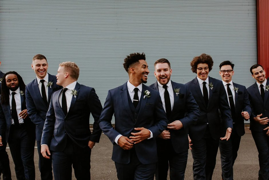 group of men cocktail wedding attire blue suits