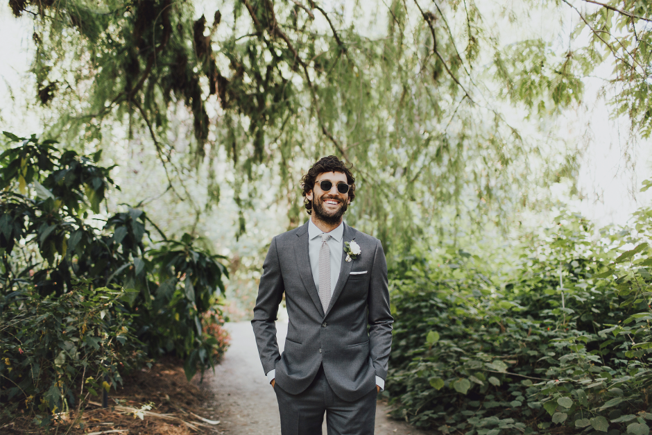 man in grey suit by the black tux