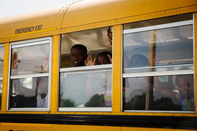 "A school bus full of children gesture and chant, ""Hands up, don't shoot"" in the St. Louis area"