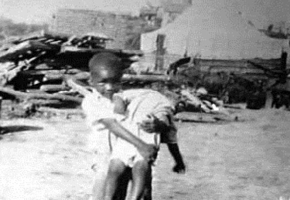 Tulsa-Race-Riot-Black-Wall-Street-child-carrying-child-060121.jpg