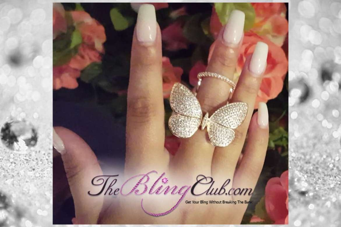 the bling club gold pave flying moving butterfly ring