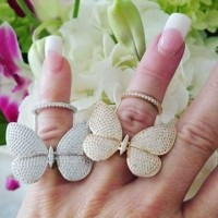 the bling club flying butterfly rings in rose gold and platinum
