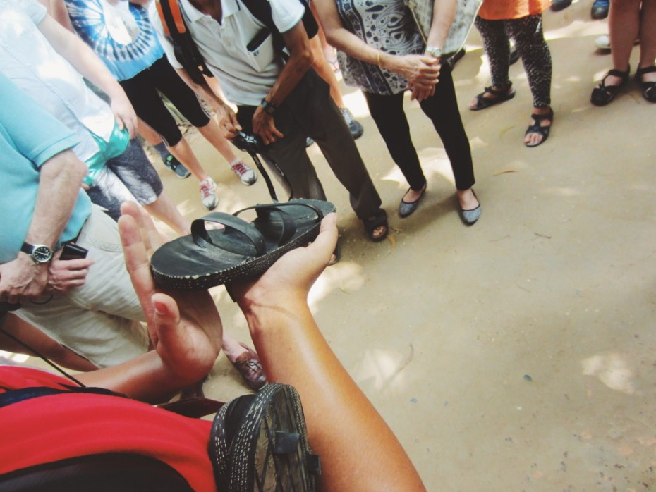 Demonstrating the functionality of their shoes made from recycled explosives.