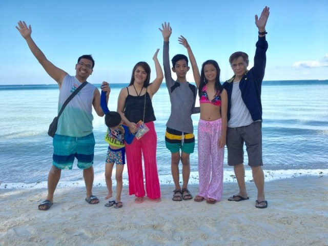 family pic taken at the beachfront of Ambassador in Paradise Boracay in our Boracay 2019 Day 3 vacation