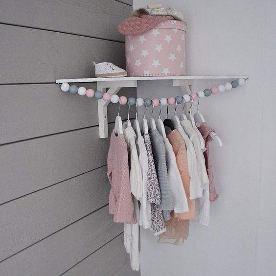 Cute corner baby clothes hanging rod