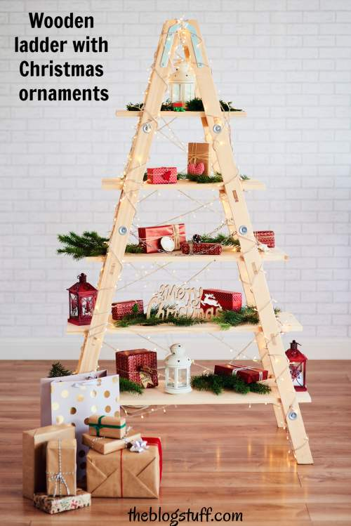 Wooden ladder with Christmas ornaments and gifts