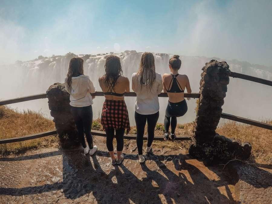 friends looking at victoria falls