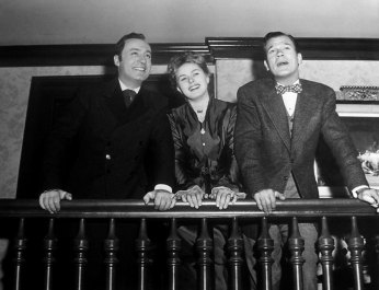 http://acertaincinema.com/media-tags/gaslight-1944/ Charles Boyer, Ingrid Bergman, and Joseph Cotten on set