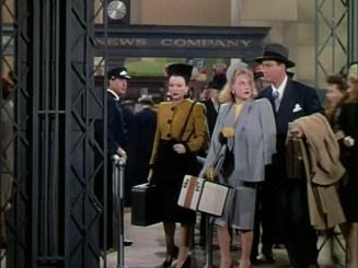 Sonja Henie clutches a train case in It's a Pleasure