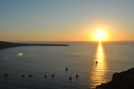 Catamarans poised for the sunset in Oia.