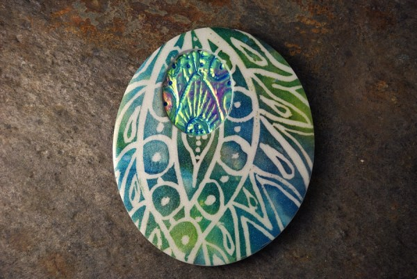 Peacock Batik polymer clay amulet with Holographic Effect in blue