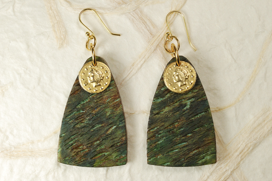 Triangular polymer clay earrings in green and brown tones with gold coins at the top.